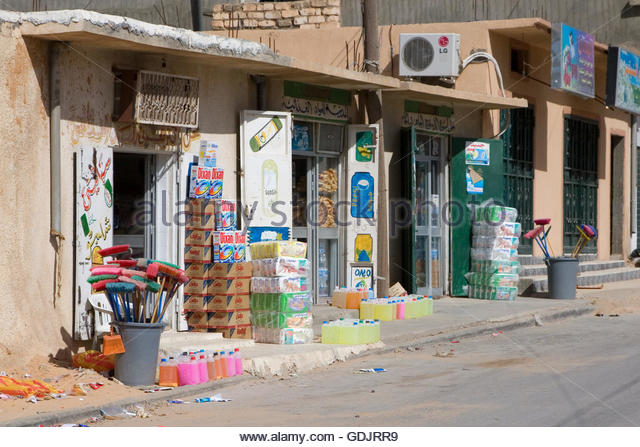 tarhouna-libya-grocery-store-street-scene-bread-brooms-disposable-gdjrr9